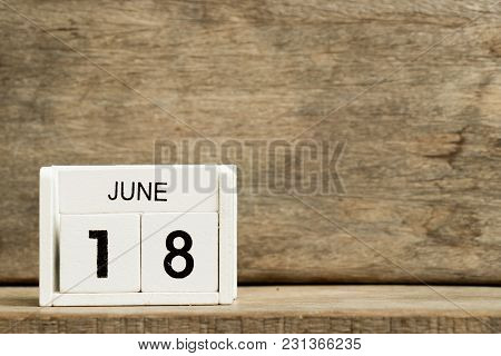 White Block Calendar Present Date 18 And Month June On Wood Background
