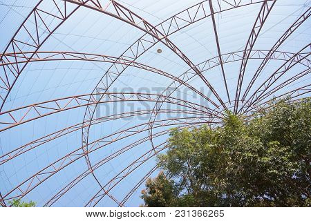 Giant Dome Bird Cage With Blue Sky Background