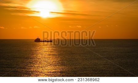 Ocean Sunset And Tanker On Horizon - View From Navigation Bridge Of A Vessel