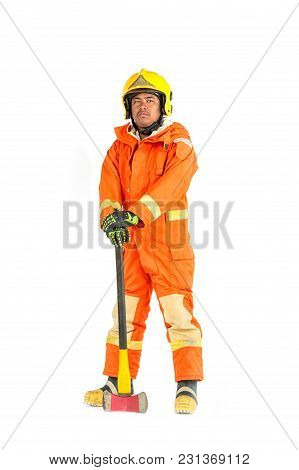 Firefighter In Uniform And Safety Helmet Standing Holding Axe Full Body Length