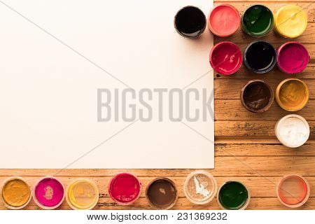 10 Colorful Gouache Jars In Triangle With Open Caps And Big White Blank Sheet Of Paper For Paintign
