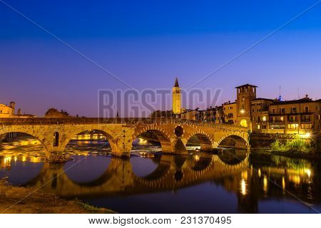 The Ponte Pietra Has The Adige River At Night