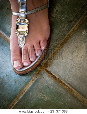 Foot In The Sandal