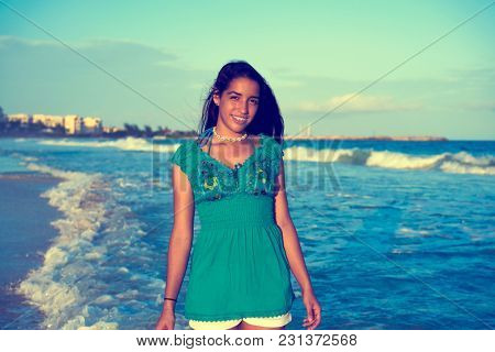 Latin beautiful girl in Caribbean beach sunset with embroidery dress