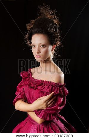 Stylized Baroque Portrait Of Woman In Historical Costume With Crinoline. Low Key