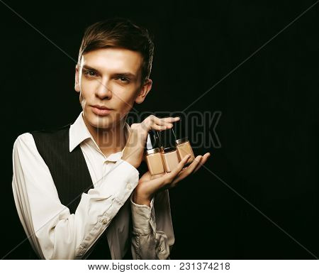 Young male make up artist posing with foundation for make-up