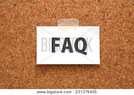 Faq On A Piece Of Paper On A Brown Cork Board. Frequently Asked Questions Concept.