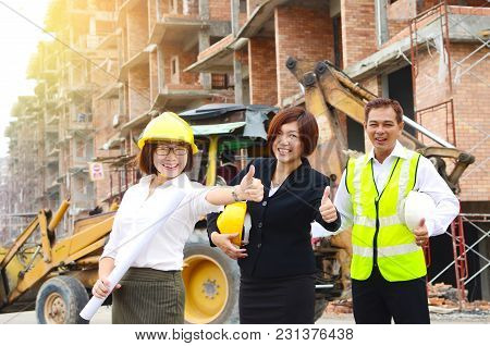 Asian Engineers Raised Their Thumbs At The Construction Site