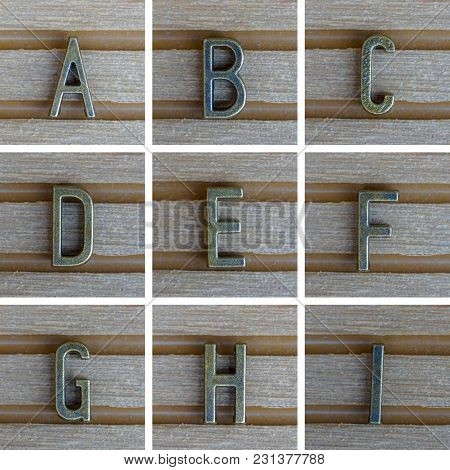 Bronz Alphabet Letter On Wooden Background. A, B, C, D, E, F, G, H, I Set 1 From 3, Search Others In