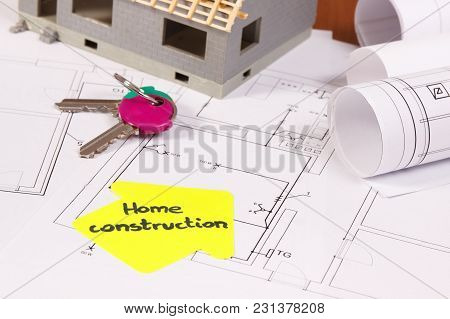 Home Keys, House Under Construction And Electrical Construction Diagrams For Use In Engineer Jobs, B