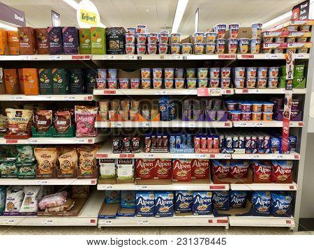 LONDON - MARCH 14, 2018: Porridge pats and muesli stock on shelves at Sainsbury's supermarket at The O2 Centre, Finchley Road, North London, UK.