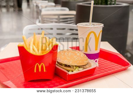 Moscow, Russia, March 15 2018: McDonald's Big Mac hamburger menu, French Fries and Coca Cola
