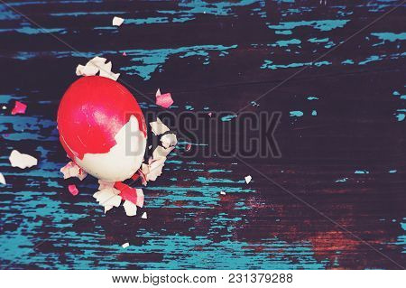 Colorful Easter Egg. Background With Easter Eggs. Red Boiled Egg In A Red Shell. Traditional Easter