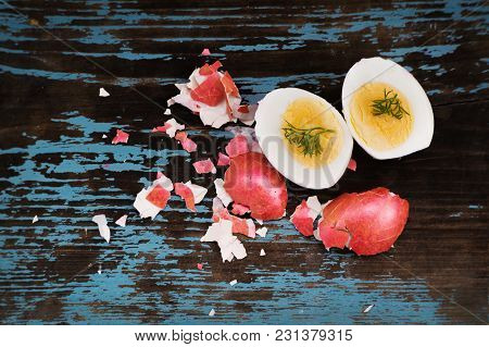 Colorful Easter Egg. Background With Easter Eggs Cut In Half With Green Dill. Two Halves. Red Boiled