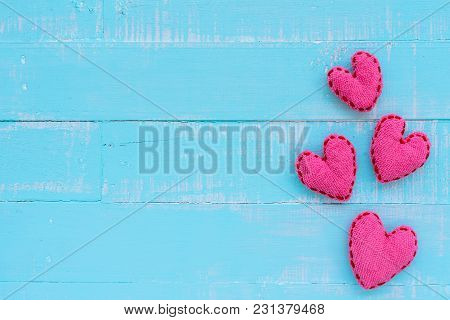 Top View  Of Handmade Pink And Red Heart On Blue And White Color Wooden Background With Pastel Vinta