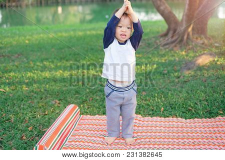 Cute Funny Smiling Asian 18 Months / 1 Year Old Toddler Baby Boy Child Try To Practices Yoga In Tree