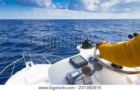 Hand Of Captain On Steering Wheel Of Motor Boat In The Blue Ocean During The Fishery Day. Success Fi