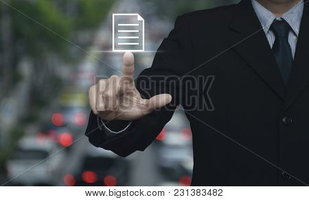 Businessman Pressing Document Icon Over Blur Of Rush Hour With Cars And Road, Business Communication