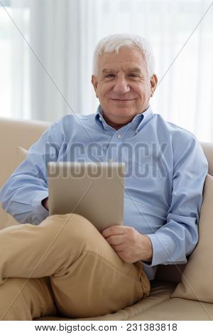 Portrait Of Happy Senior Man With Tablet Computer