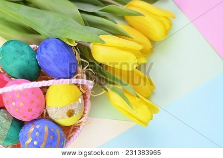 Easter Eggs Lying In A Basket. Inscription Happy Easter. Space For Text. Selected Focus.
