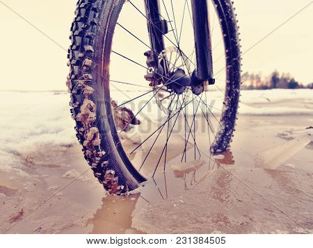 Mtb Bicycle Resting In Muddy Puddle. Adventure And Extreme Cycling Concept, Self Motivation And Insp