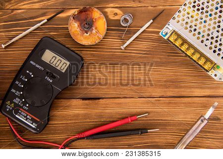 Set For Soldering Wire And Shrink Soldering Tube With Solder Next To Screwdriver And Multimeter On A