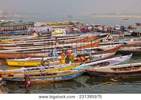 Varanasi, India - December, 9th, 2017. Boats On The Ghats Of Varanasi.