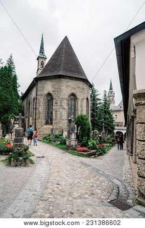Salzburg, Austria - August 6, 2017: The Petersfriedhof Or St. Peter Cemetery Is Located At The Foot