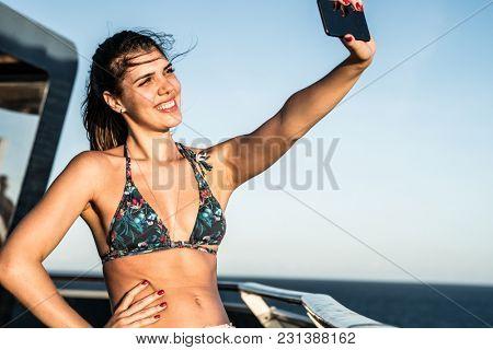 Girl Taking a Selfie on Cruise Ship