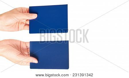 Blue International Passport In Hand Isolated On White Background. Copy Space, Template