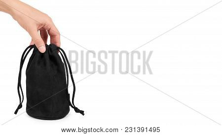 Black Textile Sack In Hand Isolated On White Background. Copy Space, Template.