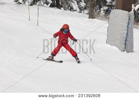 Children Starting To Learn How To Ski. Winter Sport. Horizontal