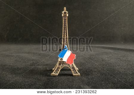 Eiffel Tower Toy Miniature On Black Background