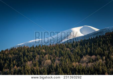 Mountain Landscape In Winter Season, The Stoh Hill In The Vratna Valley At The National Park Mala Fa