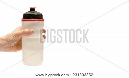 Hand Of Young Girl Holding Sport Water Bottle. Isolated On White Background. Copy Space, Template