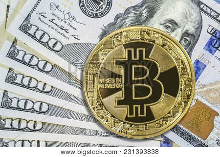 Golden Bitcoin On Hundred Dollar Bills. Cryptocurrency Background
