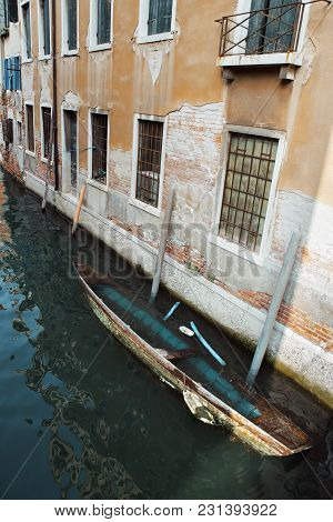 A Sinking Boat In Venice Italy. Concept - Venition Sinking, The Old City Destructing By Sea Water.