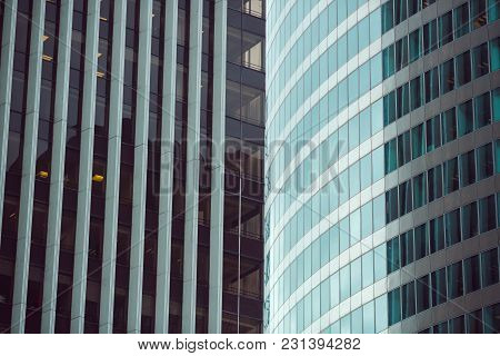 Business Abstract - Modern Office Building Covered With Glass Against Blue Sky. Details Of Architect