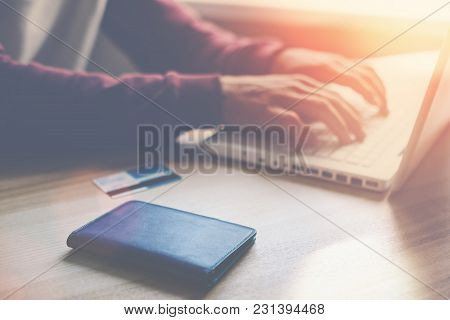 Man With Laptop And Credit Card Making Online Shopping, Intentional Sun Glare And Lens Flares