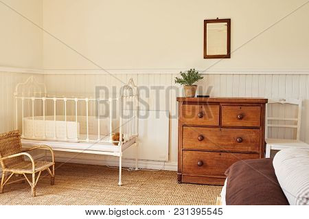 Cot In The Comfortable Bedroom Of A Country Home