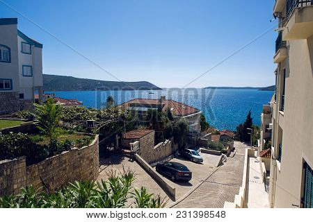 Herceg Novi, Montenegro - September 14: Street With Red Private House And People In Montenegro In Th
