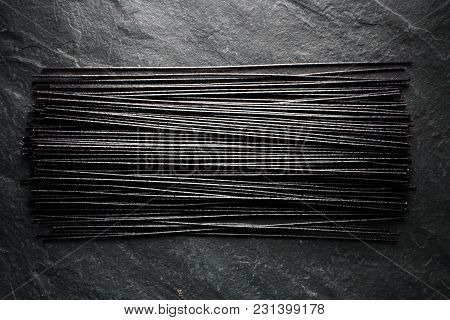 Black Dry Rice Noodles On Black Stone Horizontal