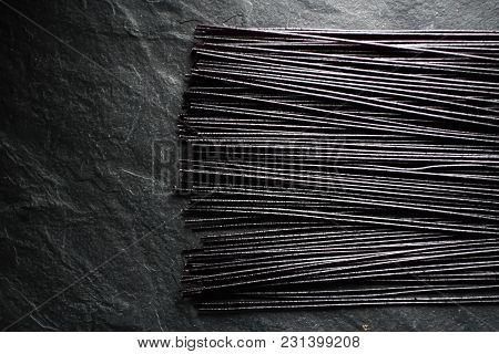 Black Dry Rice Noodles On Black Stone Free Space Horizontal