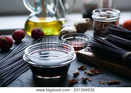 Black Rice Vermicelli, Vinegar And Vegetables On A Black Slate. Asian Cuisine Horizontal