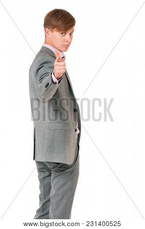 Young handsome man in gray suit isolated on white background. Portrait of a confident businessman looking and pointing at camera choosing you.