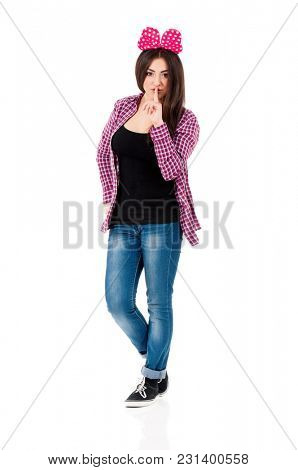 Cheerful teen girl with big red bow, isolated on white background