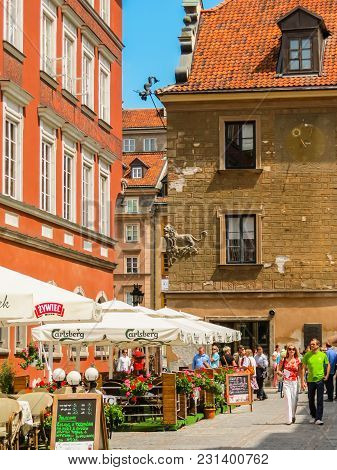 Warsaw, Poland - June 29, 2013: Warsaw Postcard. Marketplace Square And Ancient Houses Restored In T