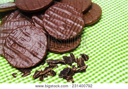Round Chocolate Biscuits On Green Stripped Background