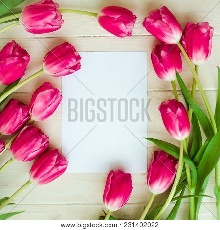 Bouquet Of Tulips On A Wooden Background With Space For Text. Selective Focus
