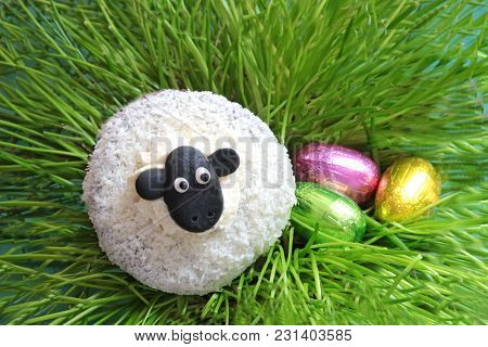 Easter Eggs And A Cute Sheep, Made Of A Muffin, Lying Between Chives